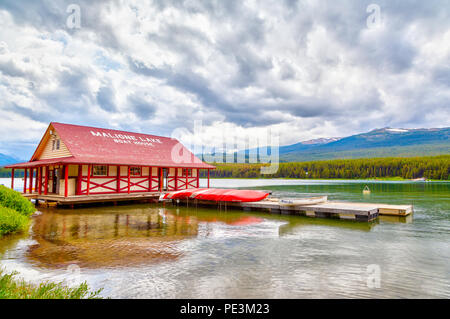 JASPER, CANADA - JUL 10, 2018: Colorful canoes lie on the Maligne Lake Boat House dock in Jasper National Park, Alberta, Canada. The lake is famous fo - Stock Image