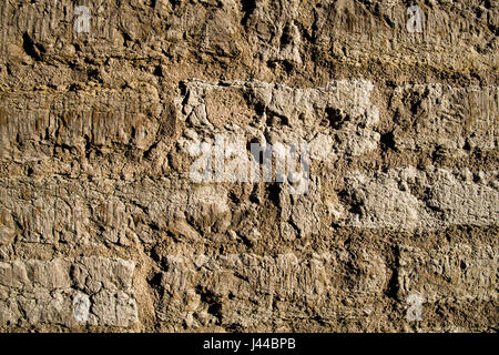 Old decayed stone wall - Stock Image