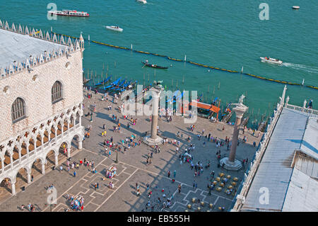 Doges Palace and Columns of Lion of St Mark and Saint Theodore and gondalas from St Marks Bell Tower Venice Italy - Stock Image