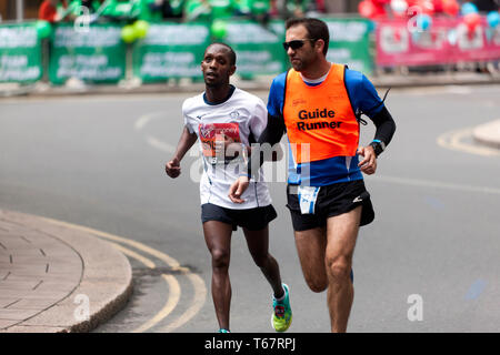 Avi Adhanany Solomon with his guide runner,  competing for Israel,  in the World Para Athletic Championships, part of the 2019 London Marathon. He finished 16th, in the T11/12 category - Stock Image