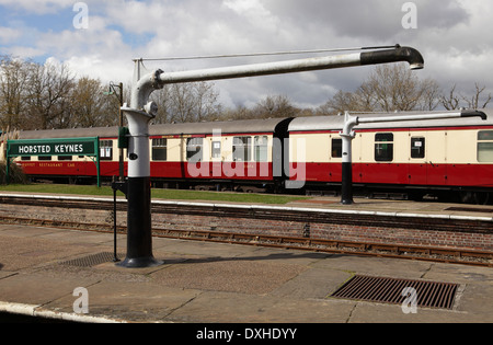 Water cranes and rolling stock at Horsted Keynes station, Bluebell railway - Stock Image