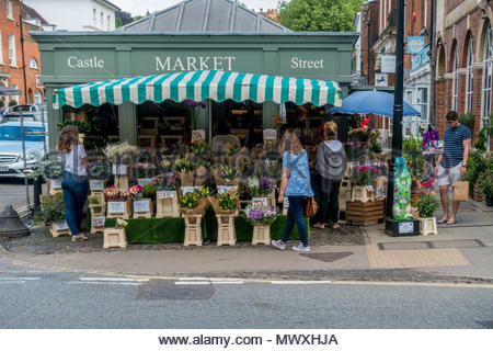 Customers at the flower stall on the street market in Farnham, Surrey - Stock Image