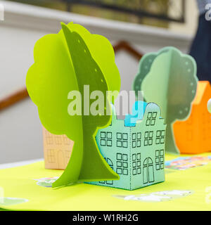 Green house and a tree made of paper - Stock Image
