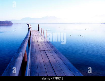 Wooden Pier on the Chiemsee Lake, Bavaria, Germany - Stock Image