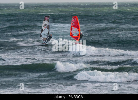 Windsurfers in rough seas on East Wittering Beach, Nr. Chichester, West Sussex, United Kingdom, England - Stock Image