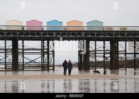 Hastings, East Sussex, UK. 12 Jan, 2019. UK Weather: Winter weather with a slight breeze in the air that is expected to last throughout the day as a few people take a morning stroll around the seafront as the tide is out. Hastings pier on a cold winters morning. © Paul Lawrenson 2018, Photo Credit: Paul Lawrenson / Alamy Live News - Stock Image
