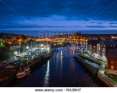 Whitby, North Yorkshire, UK. 1st Jan 2019. Weather: Cloudy skies at dawn over Whitby Harbour, North Yorkshire on New Year's Day. 1st January 2019. © Gary Clarke/Alamy Live News - Stock Image