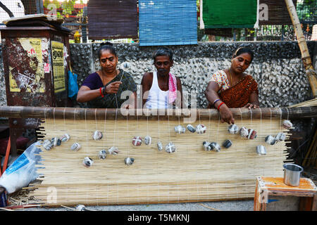 Tamil men and women working on a new bamboo curtain in the streets of Chennai. - Stock Image