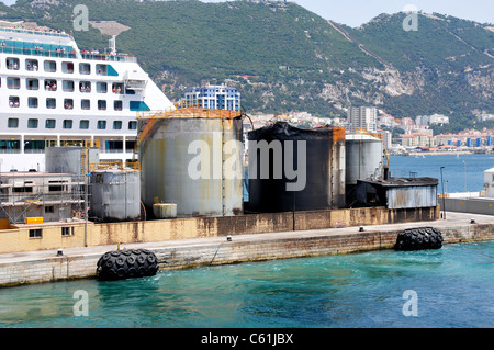 Fuel storage depot tanks by cruise terminal, Gibraltar following fire in May 2011 - Stock Image