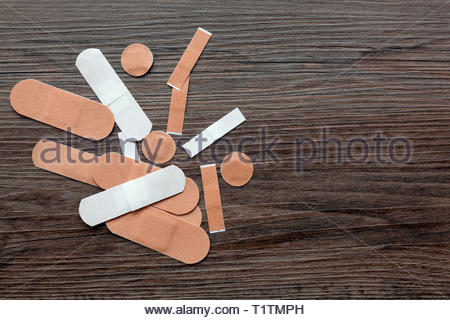 Assortment of fabric plasters - copy space provided - Stock Image