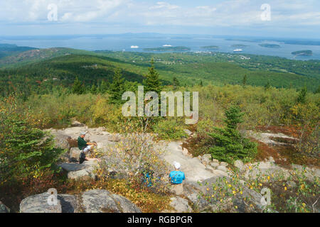 Hikers resting on the top of Cadillac Mountain, Acadia national Park, USA. - Stock Image