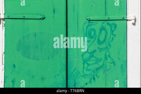 old green doors in Gustavia, St Barts - Stock Image