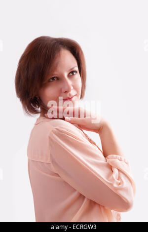 Portrait of a young woman in a pink blouse - Stock Image