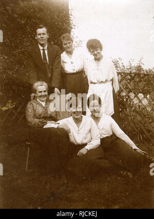 Group photo, family of six in a garden. - Stock Image