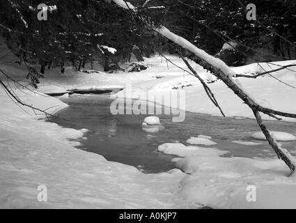 Icy winter river in Jericho Vermont,USA - Stock Image