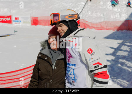 Quebec, Canada. , . World moguls champion, Mikael Kingsbury poses with a fan for a picture at the Canadian Moguls Championship Series presented by Toyota at Val Saint-Come Credit: richard prudhomme/Alamy Live News - Stock Image