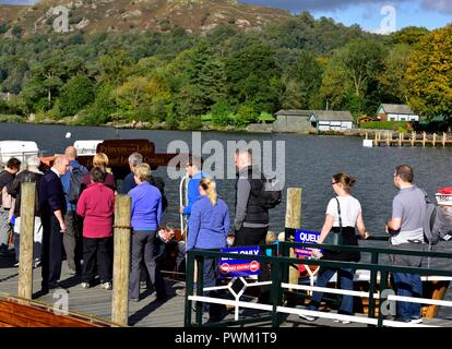 Waterhead boat jetty,tourists boarding a boat trip on lake windermere,Ambleside,Lake district,Cumbria,England,UK - Stock Image
