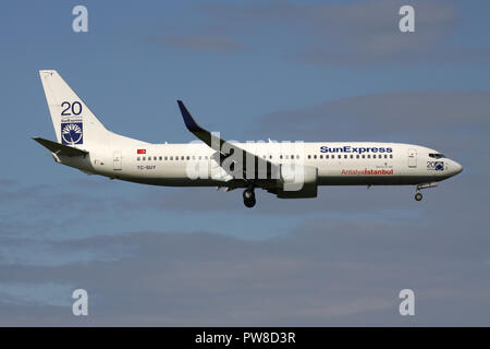 Turkish SunExpress Boeing 737-800 (old livery) with 20 Years stickers) with registration TC-SUY on short final for runway 14 of Zurich Airport. - Stock Image