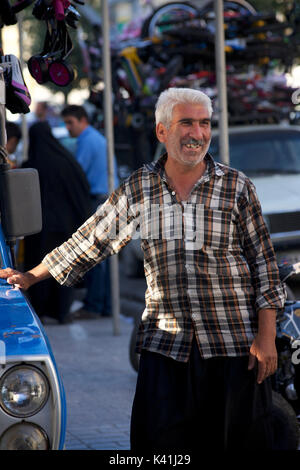 Iranian man beside his truck, Shiraz, Iran - Stock Image