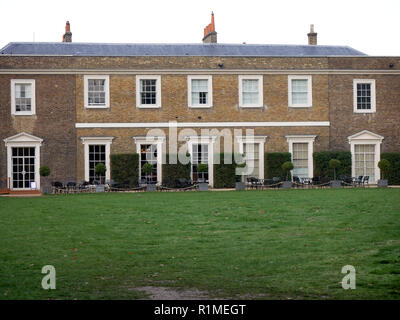 Lawn and restaurant outside seating area of Fulham Palace - Stock Image