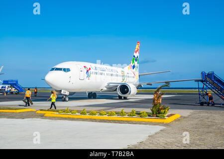 Caymen Airways arrives Juan Manuel Galvez Airport Roatan Honduras. - Stock Image