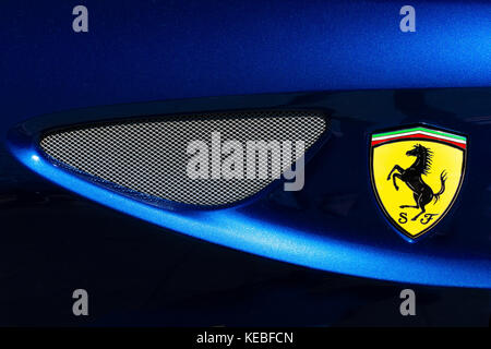 The complex curves of Ferrari bodywork and the prancing horse logo - Stock Image