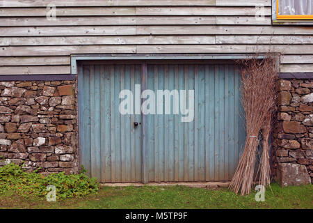 Old barn made with a mix of building materials - Stock Image