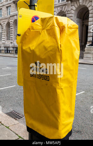 A parking bay machinewith a yellow cover indicating that it is currently suspended in Liverpool May 2018 - Stock Image