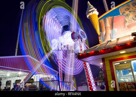 A night at the carnival with fun rides and confections. - Stock Image