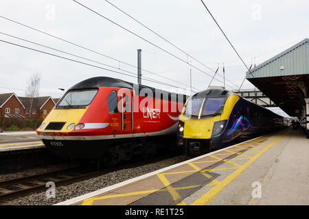 LNER Class 43, 43305, and First Hull Trains, Class 180 Adelante waiting at the platform, Grantham railway station, Lincolnshire, England - Stock Image