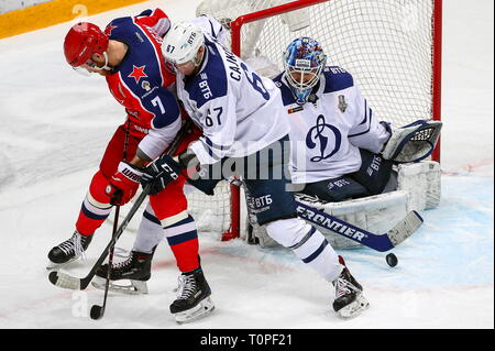 Moscow, Russia. 21st Mar, 2019. MOSCOW, RUSSIA - MARCH 21, 2019: HC CSKA Moscow's Ivan Telegin and HC Dynamo Moscow's Michal Cajkovsky, goaltender Alexander Yeryomenko (L-R) in action in Leg 5 of their 2018/19 KHL Western Conference semi-final playoff tie, at CSKA Arena. Mikhail Tereshchenko/TASS Credit: ITAR-TASS News Agency/Alamy Live News - Stock Image