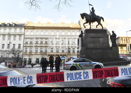 A man, 54, poured a combustible on himself and set himself on fire at the Saint Wenceslas statue in Prague centre, Czech Republic, on January 18, 2019, but the passers-by managed to put out the fire, the police has tweeted. The spokeswoman for the emergency service Jana Postova said the fire on the man had been put down. An eye-witness said he could see a burning man who had his face and hands burnt. On the scene of the accident, in which the police are intervening, there are burnt clothes and a used fire extinguisher. The paramedics said the man suffered burns on 30 percent of his body. He wa - Stock Image