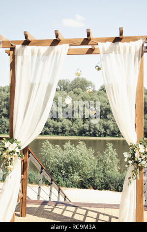 wedding arch on the river bank - Stock Image