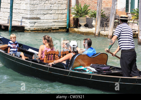 Family gondola ride in Venice Italy - Stock Image