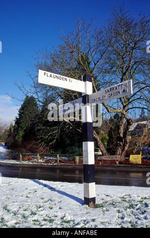 Signpost Outside The Plough Public House, Belsize, Hertfordshire - Stock Image