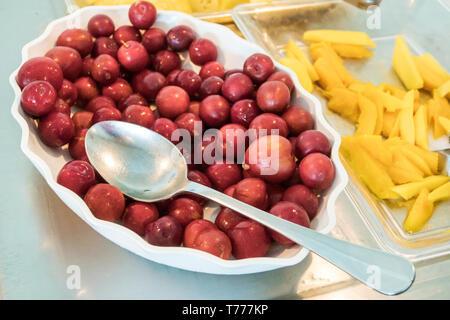 Cartagena Colombia El Laguito Hotel Dann Cartagena hotel restaurant free included breakfast buffet fruit bowl serving spoon grapes mango - Stock Image
