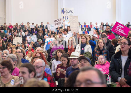 Westbury, USA. January 15, 2017. Hundreds of people, many with protest signs, are in the audience at the 'Our - Stock Image