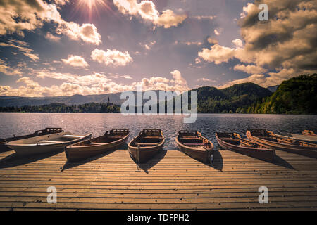 Beautiful landscape of wooden boats near the lake Bled, Bled, Slovenia in summer - Stock Image