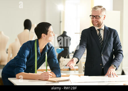Conversation in studio - Stock Image