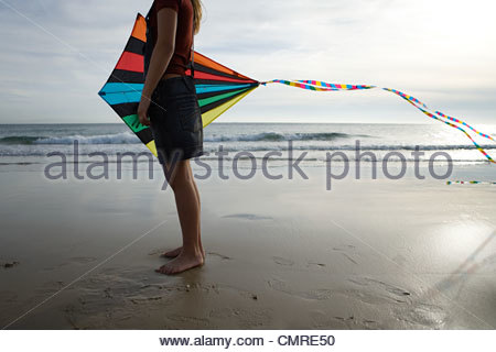 Girl by the sea with kite - Stock Image