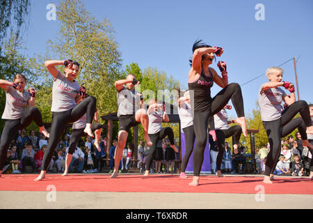 Nis, Serbia - April 20, 2019 Piloxing sport training big group of people on sunny spring day outdoor with happy instructor - Stock Image