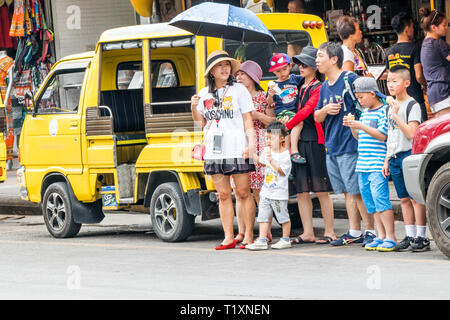 Phuket, Thailand 17th January 2019: Chinese tourists waiting to cross the road in Patong beach. The resort town is renowned worldwide. - Stock Image