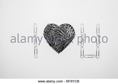 Heart shape made with paperclips on white background - Stock Image