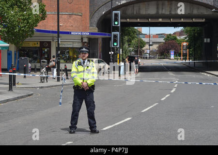 London, United Kingdom. 23 June 2018. Detectives are investigating an unexplained death outside Greenford Station. Police were called to Oldfield Lane North at 01:46BST 23rd June following reports of a fight. Officers and the London Ambulance Service attended and found two unresponsive men aged in their late 30s. The first man was pronounced dead at the scene. Credit: Peter Manning/Alamy Live News - Stock Image