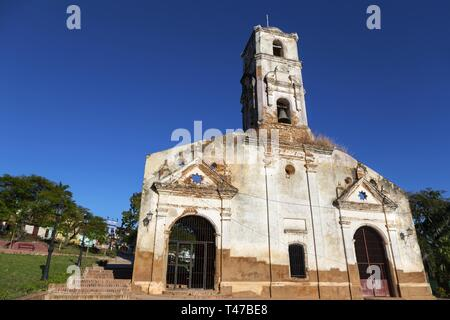 Front Facade Wall Exterior of old ruined Spanish church with Bell Tower in Unesco World Heritage Site Trinidad, Cuba - Stock Image