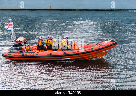 Four members of the RNLI on a rescue RIB - Stock Image