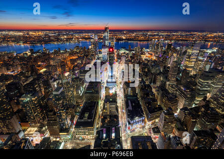 New York City, NY, USA - Mach 11, 2018: Aerial view of Midtown West Manhattan with new Hudson Yards skyscrapers under contruction at twilight. - Stock Image