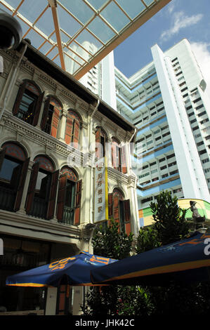 Traditional shophouses on street corner, with modern multi-storey apartment block in background, Smith Street, Chinatown, - Stock Image