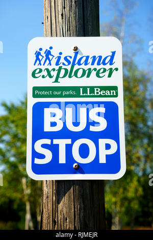 Bus stop sign for the Island Explorer, a shuttle service providing free transportation in and around Acadia National Park, Maine, USA. - Stock Image