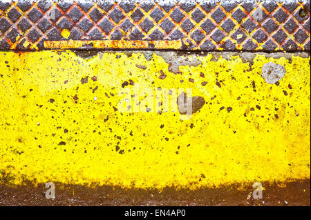 Yellow painted metal surface as a background texture - Stock Image